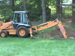 Perc test - backhoe digs a series of holes